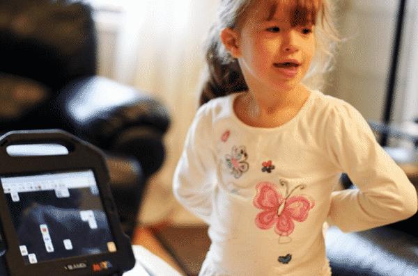 4 Year Old Girl Maya Uses SfY To Speak, Image Credit: timenerdworld.files.wordpress.com