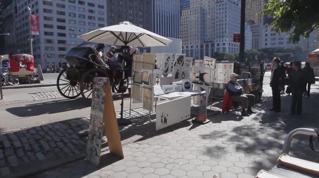 Man Sitting Before Banksy's Arts